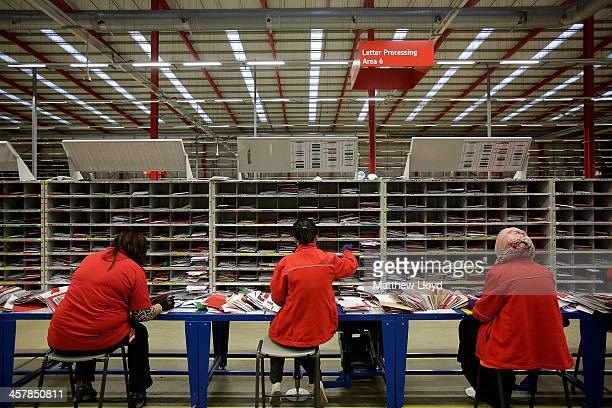 Letters that were unable to be automatically sorted by machines are hand processed at Royal Mail's Swan Valley mail centre on December 18 2013 in...