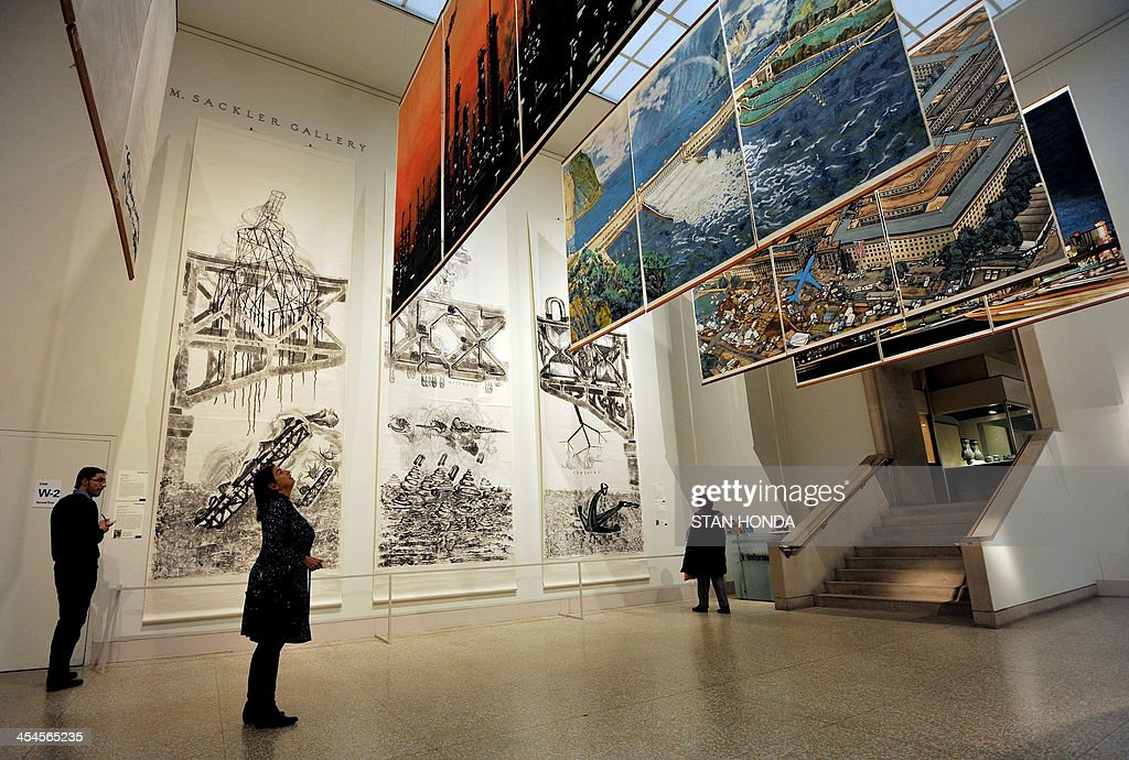 '30 Letters to Qiu Jiawa', three hanging scrolls (L) by Qiu Zhijie and 'Crying Landscape', five tryptychs (R) by Yang Jiechang, are displayed in the exhibition 'Ink Art: Past as Present in Contemporary China' at the Metropolitan Museum of Art on December 9, 2013 in New York. A major exhibition of 70 pieces of art by 35 contemporary artists born in China goes on view to the public on December 11. AFP PHOTO/Stan HONDA ++RESTRICTED