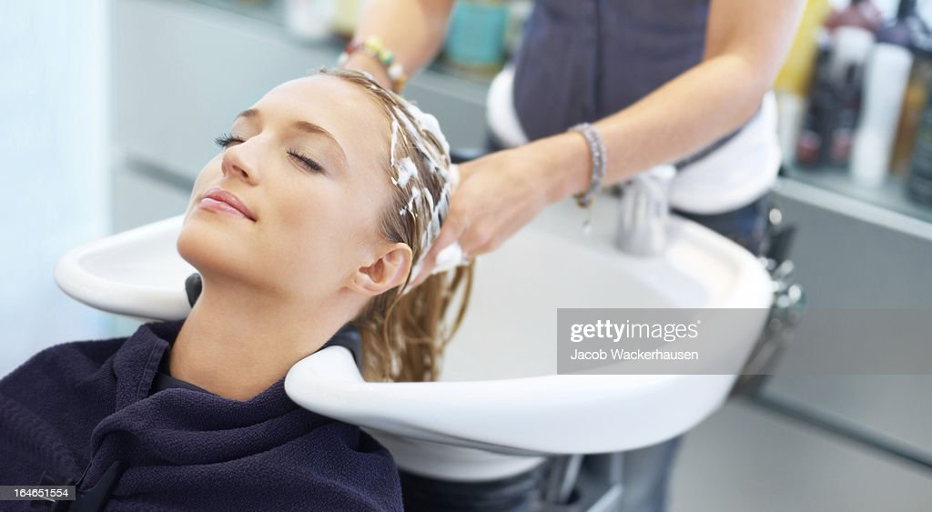 Letting experienced hands treat her tresses