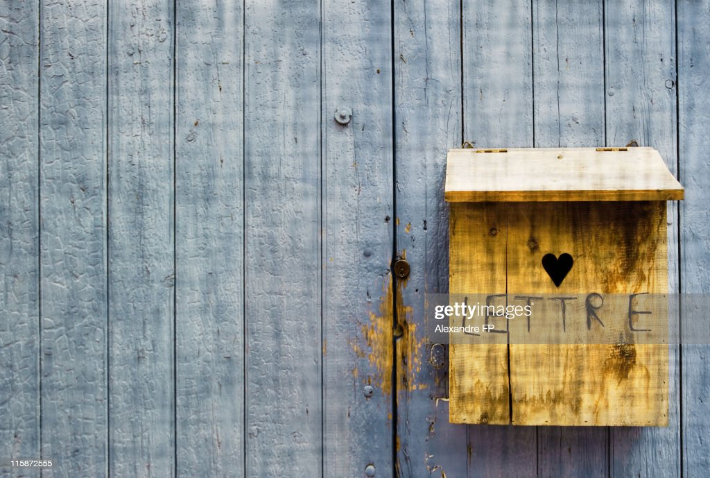 Lettre and heart carved in wooden letter box : Stock Photo