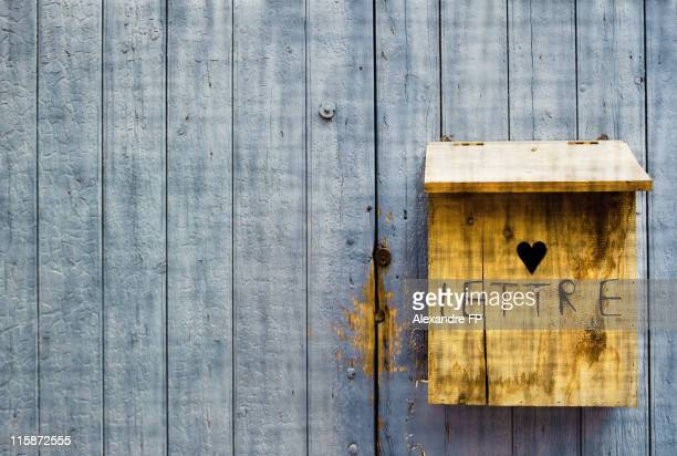 Lettre and heart carved in wooden letter box
