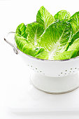 Lettuce leaves in metal strainer