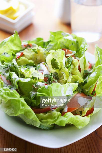 Lettuce with tomatoes and yogurt dressing