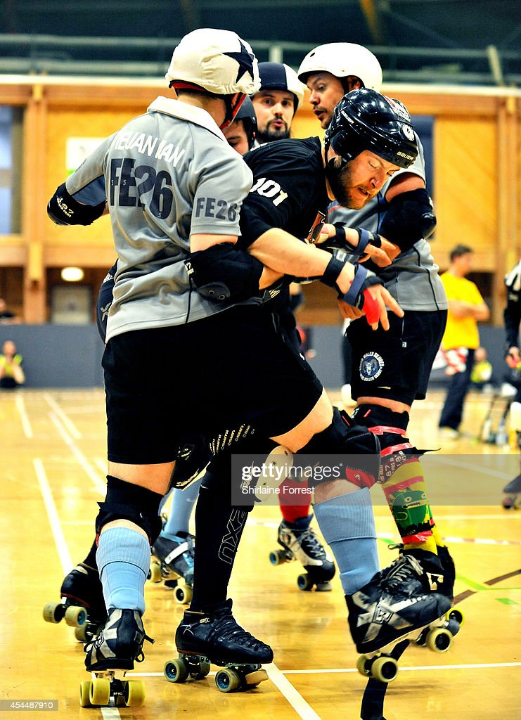 Leuan Man of South Wales Silures and Blitzkrieg of Southern Discomfort bout in the Men's European Cup roller derby tournament at Walker Activity Dome on August 31, 2014 in Newcastle upon Tyne, England.