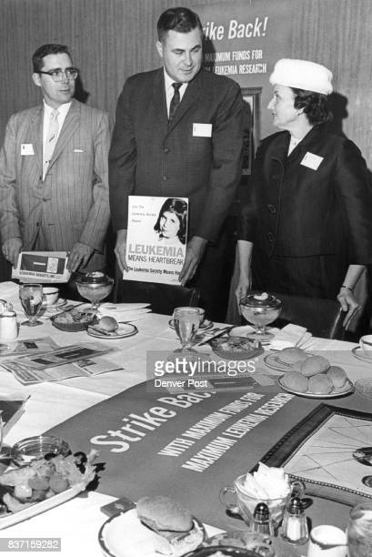 Leukemia Society Officials Prepare Literature From left are Dr Robert Collier medical adviser Frank McGregor coChairman of advanced gifts and...
