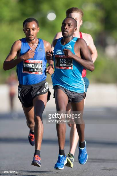 Leul Gebresilase of Ethiopia lurks in third place at the seven kilometre mark waiting to kick past Nicholas Bor of Kenya to win the Ottawa 10K during...