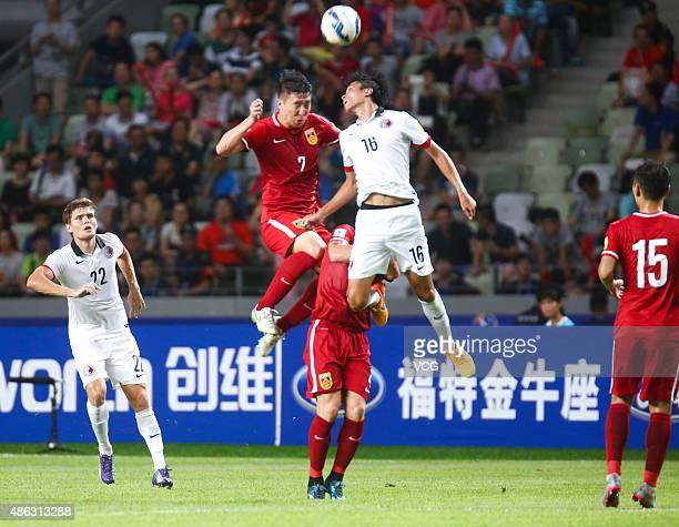 Leung Chun Pong of Hong Kong vies with Wu Lei of China during a group match between China and Hong Kong as a part of 2018 FIFA World Cup...