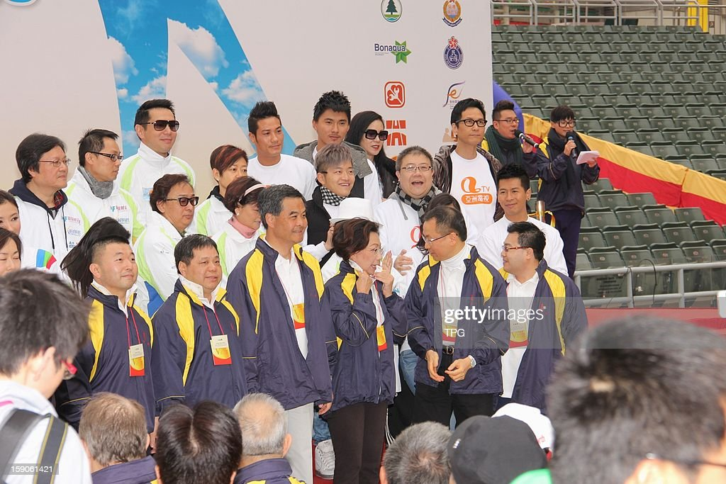 Leung Chun Ying, the chief executive of HKSAR, officiated charity activity 'Hong Kong and Kowloon Walk for Millions' with his wife on Sunday January 06, 2013 in Hong Kong, China.
