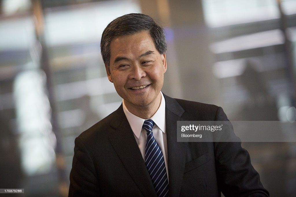 Leung Chun-ying, Hong Kong's chief executive, smiles after an interview in New York, U.S., on Wednesday, June 12, 2013. Leung, currently on an official visit to New York, declined to answer questions by reporters about how his government would handle the case of Edward Snowden, the 29-year-old U.S. contractor who says he leaked details of an electronic surveillance program. Snowden may be seeking legal help in Hong Kong after checking out of a hotel in the Chinese city on Monday. Photographer: Scott Eells/Bloomberg via Getty Images