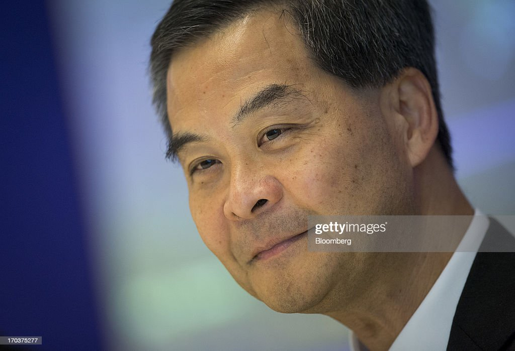 <a gi-track='captionPersonalityLinkClicked' href=/galleries/search?phrase=Leung+Chun-ying&family=editorial&specificpeople=2496883 ng-click='$event.stopPropagation()'>Leung Chun-ying</a>, Hong Kong's chief executive, smiles during an interview in New York, U.S., on Wednesday, June 12, 2013. Leung, currently on an official visit to New York, declined to answer questions by reporters about how his government would handle the case of Edward Snowden, the 29-year-old U.S. contractor who says he leaked details of an electronic surveillance program. Snowden may be seeking legal help in Hong Kong after checking out of a hotel in the Chinese city on Monday. Photographer: Scott Eells/Bloomberg via Getty Images