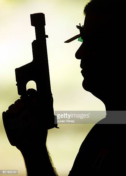 Leuris Pupo of Cuba prepares for a practice session with his pistol ahead of the Beijing 2008 Olympics at the Beijing Shooting Range on August 3 2008...