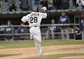 Leury Garcia of the Chicago White Sox celebrates as he scores on a wild pitch during the eleventh inning against the Minnesota Twins at US Cellular...