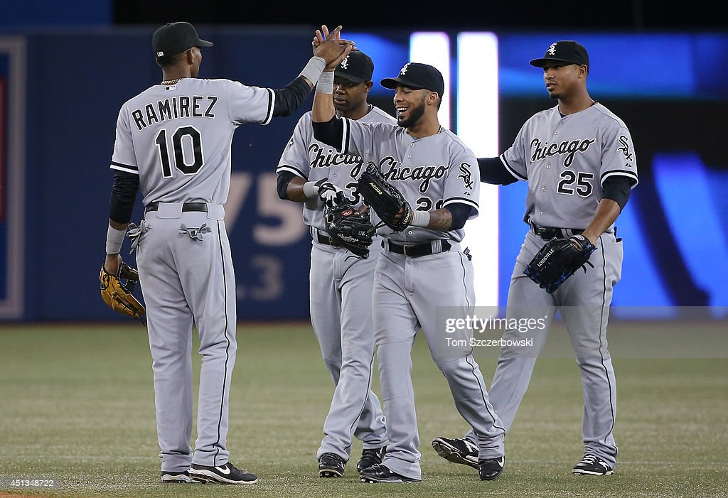 Leury Garcia #28 of the Chicago White Sox celebrates their victory with Alexei Ramirez #10 and Alejandro De Aza #30 and Moises Sierra #25 during MLB game action against the Toronto Blue Jays on June 27, 2014 at Rogers Centre in Toronto, Ontario, Canada.