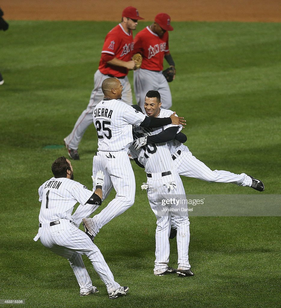 Leury Garcia #28 of the Chicago White Sox (R) is celebrates with <a gi-track='captionPersonalityLinkClicked' href=/galleries/search?phrase=Alexei+Ramirez&family=editorial&specificpeople=690568 ng-click='$event.stopPropagation()'>Alexei Ramirez</a> #10 and <a gi-track='captionPersonalityLinkClicked' href=/galleries/search?phrase=Moises+Sierra&family=editorial&specificpeople=7509137 ng-click='$event.stopPropagation()'>Moises Sierra</a> #25 after hitting a game-winning, walk-off single in the 9th inning against the Los Angeles Angels of Anaheim at U.S. Cellular Field on July 2, 2014 in Chicago, Illinois. The White Sox defeated the Angels 3-2.