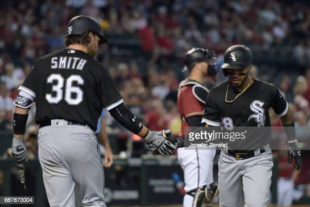 Leury Garcia of the Chicago White Sox is congratulated by Kevan Smith after hitting a solo homer in the second inning against the Arizona...