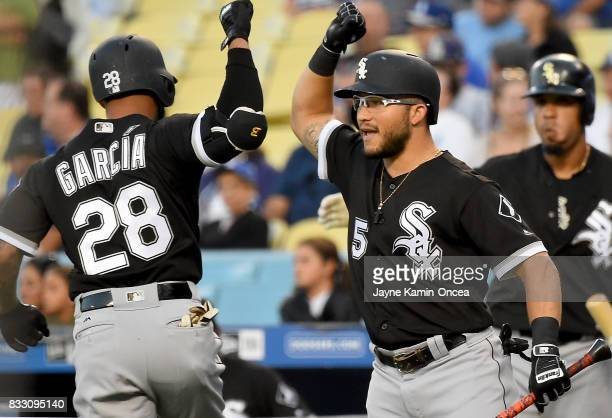 Leury Garcia of the Chicago White Sox is greeted by Yolmer Sanchez of the Chicago White Sox after hitting a solo home run in the first inning of the...