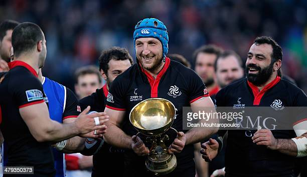Levan Datunashvili celebrates victory and top spot in the group with the ANTIM Cup after the FIRAAER European Nations Cup Division 1A match between...