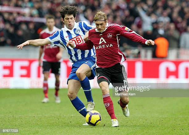 Levan Kobiashvili of Berlin battles for the ball with Marcel Risse of Nuernberg during the Bundesliga match between Hertha BSC Berlin and 1FC...