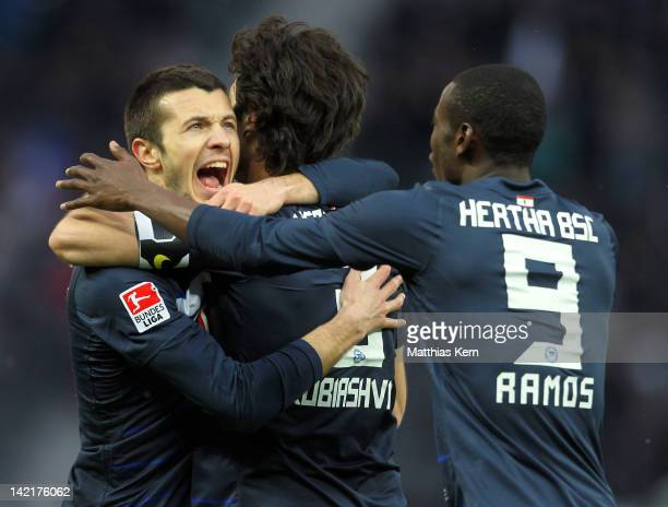 Levan Kobiashvili of Berlin jubilates with team mates after scoring the first goal during the Bundesliga match between Hertha BSC Berlin and VFL...