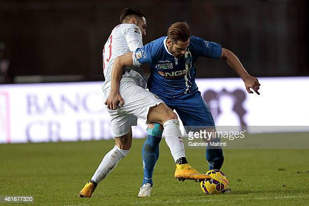 Levan Mchdlidze of Empoli FC battles for the ball with Danilo D'Ambrosio of FC Internazionale during the Serie A match between Empoli FC and FC...