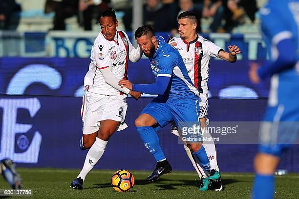 Levan Mchedlidze of Empoli FC battles for the ball with Bruno Alves of Cagliari Calcio during the Serie A match between Empoli FC and Cagliari Calcio...