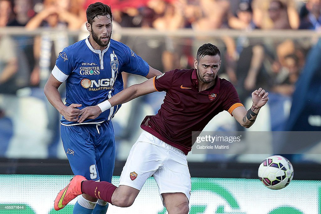 Levan Mchedlidze of Empoli Fc battles for the ball with <a gi-track='captionPersonalityLinkClicked' href=/galleries/search?phrase=Leandro+Castan&family=editorial&specificpeople=5891971 ng-click='$event.stopPropagation()'>Leandro Castan</a> of AS Roma during the Serie A match between Empoli FC and AS Roma at Stadio Carlo Castellani on September 13, 2014 in Empoli, Italy.
