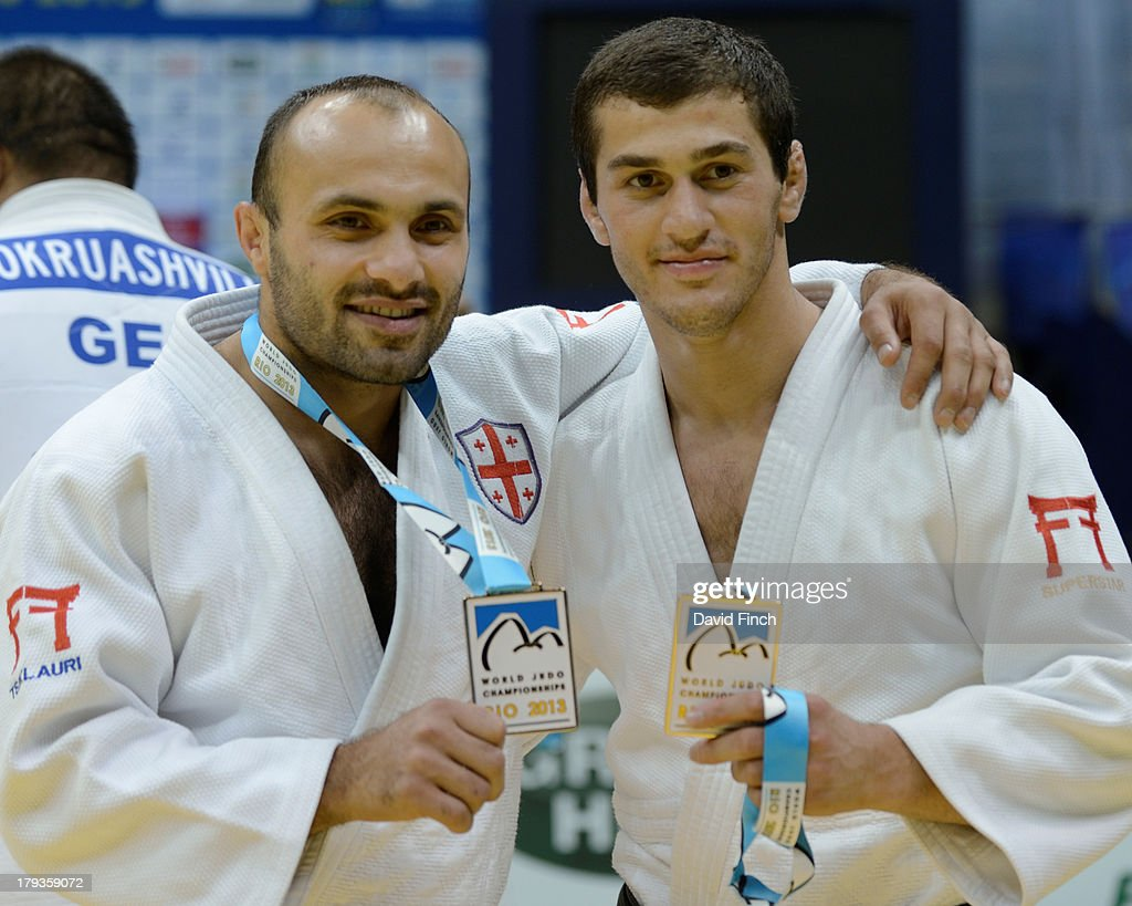 Levan Tsiklauri, left, and Avtandili Tchrikishvili show their team gold medals after Georgia won the Men's team championships at the Rio World Judo Team Championships on Day 7 on September 01, 2013 at the Gympasium Maracanazinho in Rio de Janeiro, Brazil.