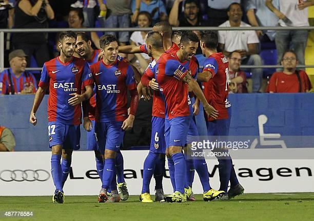 Levante players celebrate thrit first goal during the Spanish league football match Levante UD vs Sevilla FC at the Ciutat de Valencia stadium in...