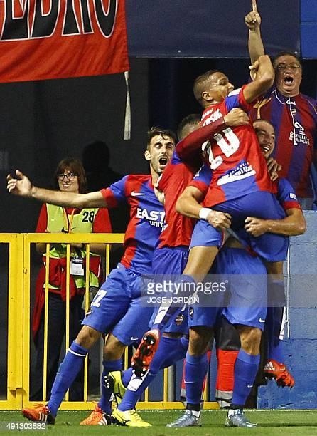 Levante's Brazilian forward Deyverson Brum Silva celebrates his goal with teammates during the Spanish league football match Levante UD vs Villarreal...