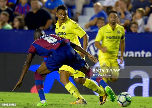 Levante's Colombian midfielder Jefferson Lerma vies with Villarreal's Colombian forward Carlos Bacca during the Spanish league footbal match Levante...