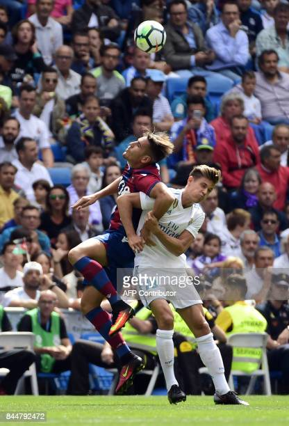 Levante's forward Alex Alegria vies with Real Madrid's miedfieder Marcos Llorente during the Spanish Liga football match Real Madrid vs Levante at...