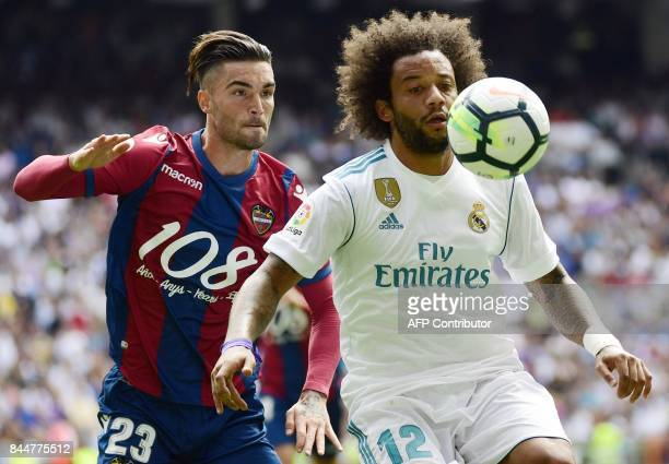Levante's forward David Jason vies with Real Madrid's Brazilian defender Marcelo during the Spanish Liga football match Real Madrid vs Levante at the...