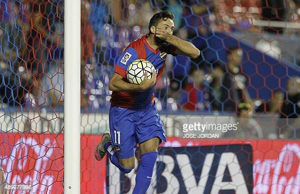 Levante's midfielder Jose Luis Morales celebrates his goal during the Spanish league football match Levante UD vs SD Eibar at the Ciutat de Valencia...