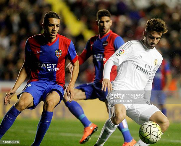 Levante's Moroccan defender Zou Feddal vies with Real Madrid's forward Borja Mayoral during the Spanish league football match Levante UD vs Real...