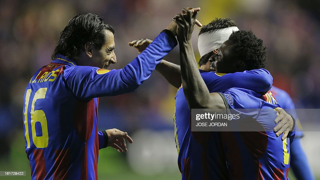 Levante's Nigerian forward Obafemi Martins (R) celebrates with his teammate midfielder Pedro Rios (L) after scoring during the UEFA Europa league round of 32 first leg football match Levante UD vs Olympiakos FC at the Ciutat de Valencia stadium in Valencia on February 14, 2013. AFP PHOTO / JOSE JORDAN