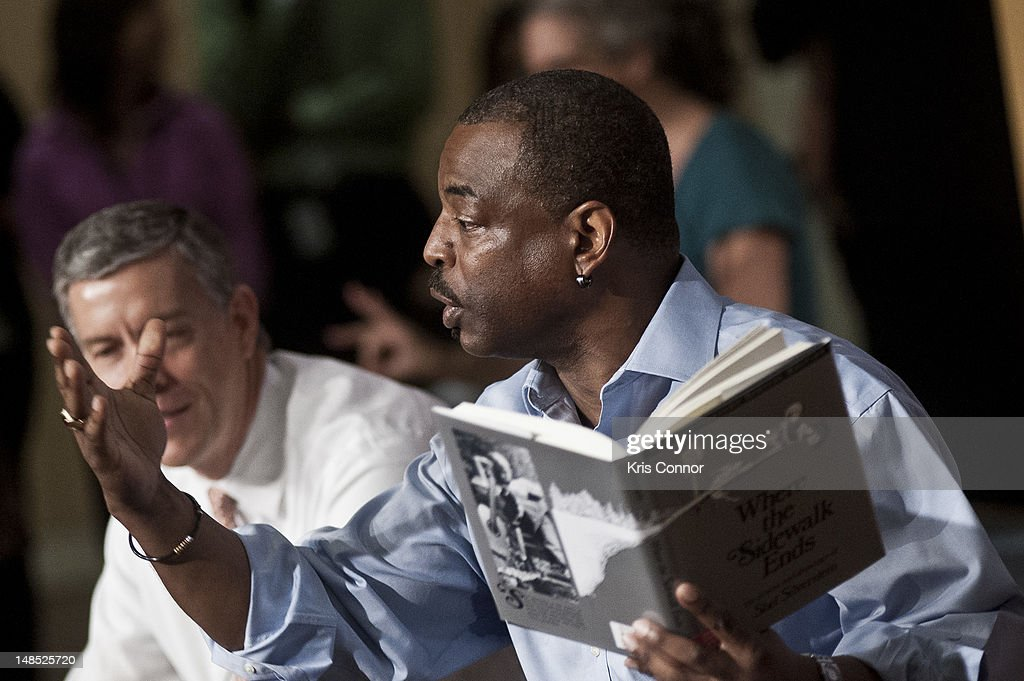 <a gi-track='captionPersonalityLinkClicked' href=/galleries/search?phrase=LeVar+Burton&family=editorial&specificpeople=241259 ng-click='$event.stopPropagation()'>LeVar Burton</a> (R) reads beside Education Minister <a gi-track='captionPersonalityLinkClicked' href=/galleries/search?phrase=Arne+Duncan&family=editorial&specificpeople=3049193 ng-click='$event.stopPropagation()'>Arne Duncan</a> during the 'Let's Read. Let's Move' summer reading event series at the Education Department on July 18, 2012 in Washington, DC.