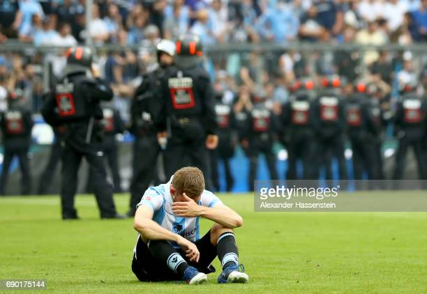 Levent Aycicek of 1860 Muenchen looks dejected after the Second Bundesliga Playoff second leg match betweenTSV 1860 Muenchen and Jahn Regensburg at...