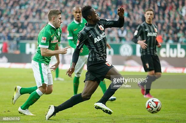 Levent Aycicek of Bremen and Abdul Rahman Baba of Augsburg compete for the ball during the Bundesliga match between SV Werder Bremen and FC Augsburg...