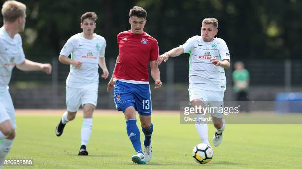 Levent Aycicek of Bremen and Jim Patrick Mueller of Unterhaching compete for the ball during the 3 Liga match between SV Werder Bremen II and SpVgg...