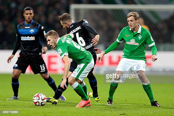 Levent Aycicek of Bremen and Marvin Bakalorz of Paderborn compete for the ball during the First Bundesliga match between SV Werder Bremen and SC...