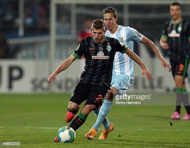 Levent Aycicek of Bremen and Tim Danneberg of Chemnitz vie during the DFB Cup second round match between Chemnitzer FC and Werder Bremen at Stadion...
