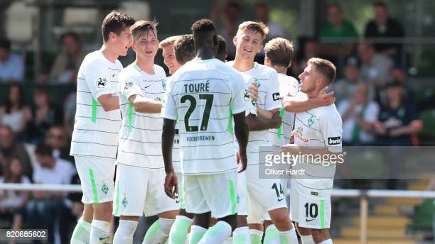 Levent Aycicek of Bremen celebrates with teammates after his team's third goal during the 3 Liga match between SV Werder Bremen II and SpVgg...