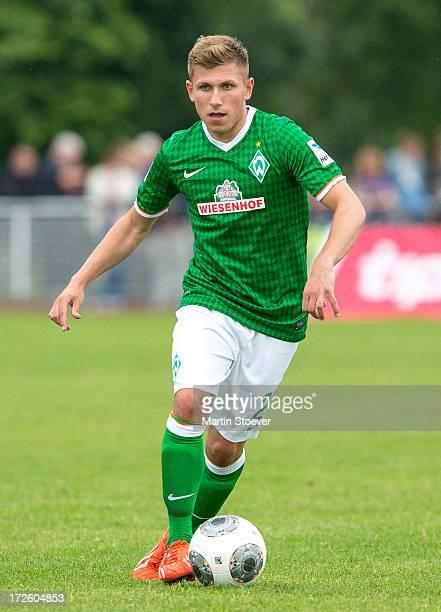 Levent Aycicek of Bremen plays the ball during the preseason friendly match between SV Concordia Suurhusen and Werder Bremen at Sportplatz an der...