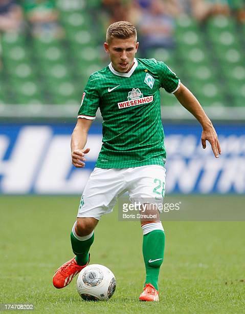 Levent Aycicek of Bremen runs with the ball during the preseason friendly match between Werder Bremen and Fulham at Weser Stadium on July 28 2013 in...