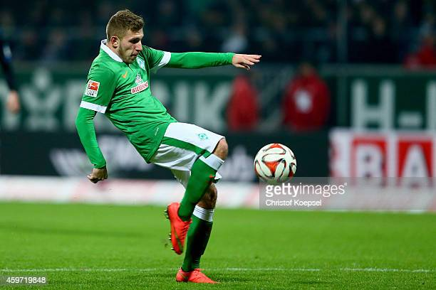 Levent Aycicek of Bremen shoots the ball during the Bundesliga match between Werder Bremen and SC Paderborn at Weserstadion on November 29 2014 in...
