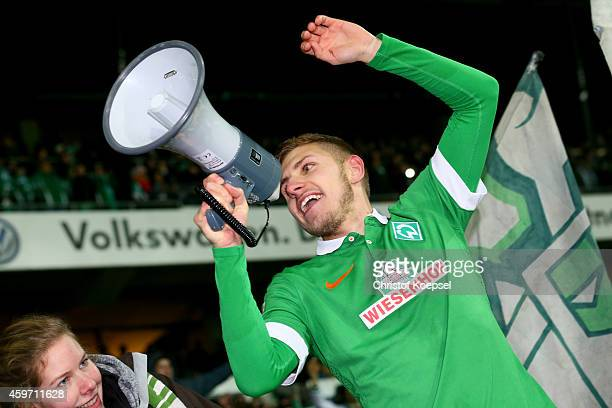 Levent Aycicek of Bremen sings with the fans after the Bundesliga match between Werder Bremen and SC Paderborn at Weserstadion on November 29 2014 in...