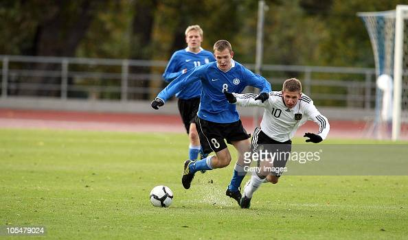 Levent Aycicek of Germany and Marten Saarlas of Estonia battle for the ball during the U17 Euro Qualifier match between Estland and Germany at the...