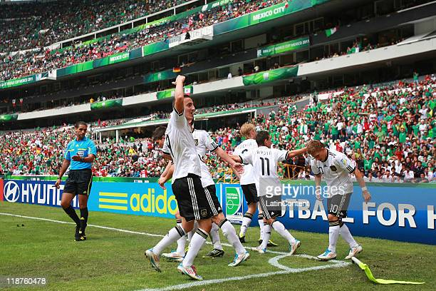Levent Aycicek of Germany celebrates with teammates a scored goal against Brazil during the FIFA U17 World Cup Mexico 2011 3rd/4th play off match...