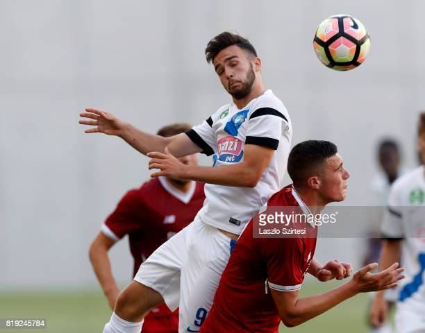 Levente Lustyik of MTK Budapest II battles for the ball in the air with Lloyd Jones of FC Liverpool U23 during the Preseason Friendly match between...