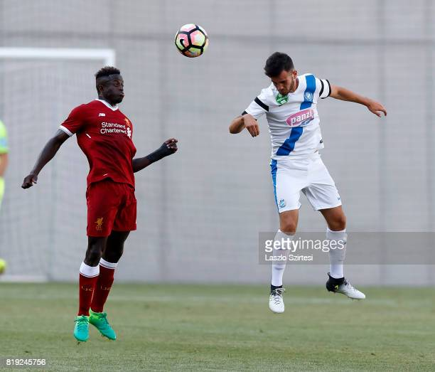 Levente Lustyik of MTK Budapest II competes for the ball in the air with Toni Gomes of FC Liverpool U23 during the Preseason Friendly match between...
